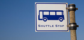 Sign Reading Shuttle Stop